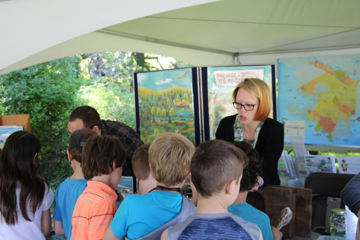 Students visit exhibitor's booth at Esquimalt's Earth Day Celebration in Highrock Park.