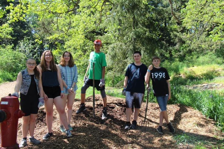 Hard working students taking a quick break from removing invasive species from Esquimalt's Highrock Park during Earth Day celebrations.